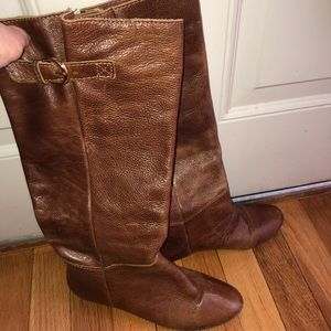Brown tall leather boots.